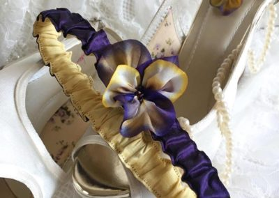 Purple and yellow silk garter